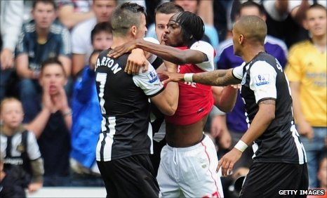 Newcastle's Joey Barton (left) and Arsenal's Gervinho
