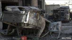 Damaged police cars in Hama, Syria (taken on government-led media tour 11 Aug 2011)