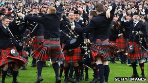 Members of Field Marshal Montgomery Pipe Band celebrate their victory