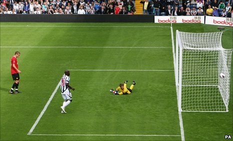 Manchester United goalkeeper David De Gea looks into the net after West Brom's Shane Long (not pictured) scores his side's equaliser