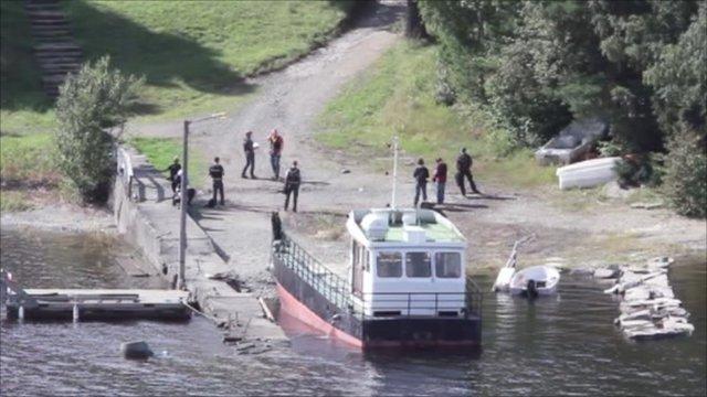 Anders Behring Breivik and police on the island of Utoeya