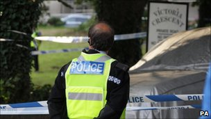 A police officer at the scene in Victoria Crescent, St Helier