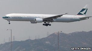 A Cathay Pacific plane prepares to land in Hong Kong