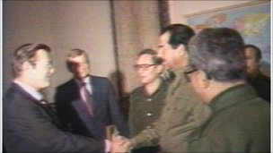 Rumsfeld shakes hands with Hussein