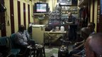 Men watch the trial in a Cairo coffee bar, 15 August