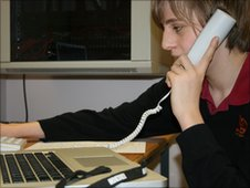 School Reporter using telephone