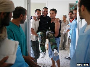 Injured rebel fighter is brought to a hospital outside Zawiya (15 August 2011)