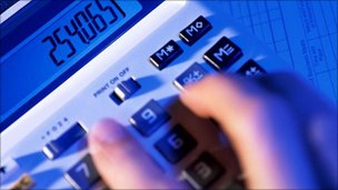 fingers on calculator
