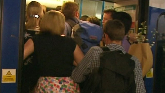 Commuters pushing onto a train