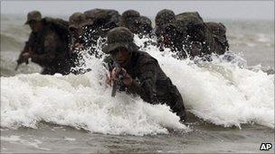 South Korean special warfare command soldiers perform a sea infiltration drill in Taean, South Korea on Tuesday
