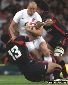 Mike Tindall is tackled by the Wales defence on Saturday