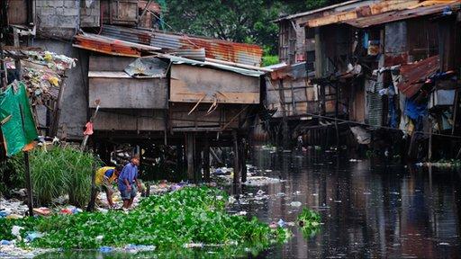 Slums line the Estero de San Miguel canal in Manila