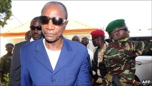 Guinea's President Alpha Conde arrives at his home in the capital, Conakry, after his victory in elections last year
