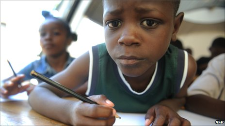 Haitian school child looking a bit perplexed