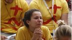 A pilgrim cries during prayers at Madrid's Retiro park on the first day of the World Youth Day meeting in Madrid August 16, 2011.