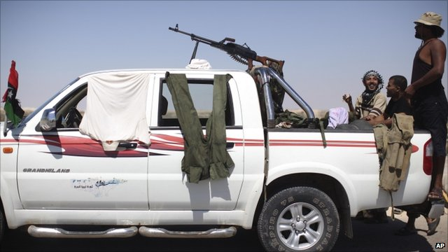 Rebel fighters near Brega, Libya, on Monday