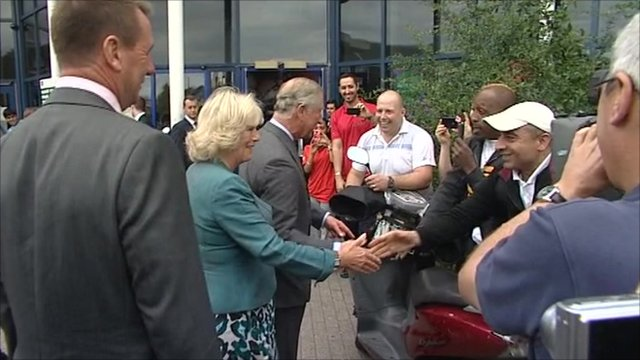 Charles and Camilla greet people outside Tottenham Green Leisure Centre