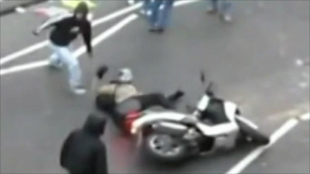 Man pulled from scooter during riots