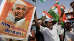 Supporters of Indian rights activist Anna Hazare, portrait seen, shout slogans during a rally in support of Mr Hazare's fight against corruption, in Mumbai