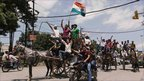 Supporters of Indian anti corruption activist Anna Hazare in horse carts take out a rally in his support in Allahabad
