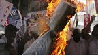 Activists from Communist Party of India (CPI) and supporters of Anna Hazare burn an effigy representing the United Progressive Alliance (UPA) government during a protest in the southern Indian city Hyderabad