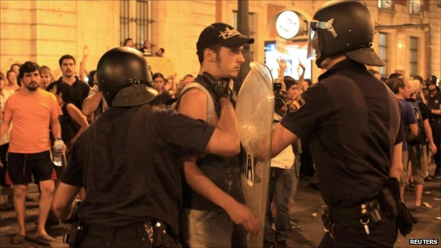 Protesters and police in Madrid