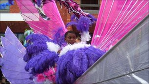 A boy in colourful costume at St Paul's Carnival in Bristol