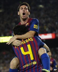 Messi celebrates scoring the winner with Fabregas