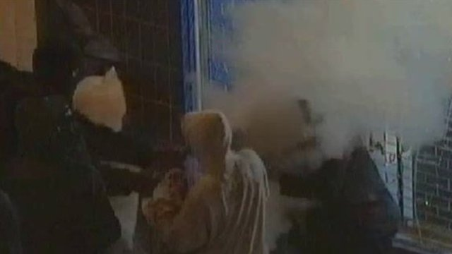 Looters attack a man with a fire extinguisher by spraying the contents in his face