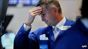 A trader holds his head