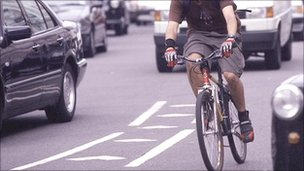 A cyclist in traffic