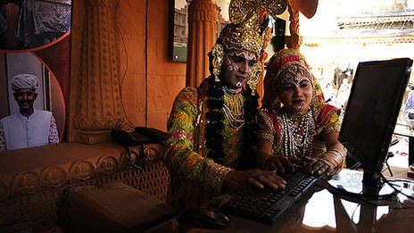 Performers working at a computer