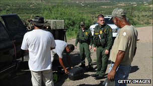 US border patrol officers stopping men to check their identification near the border of Texas and Mexico