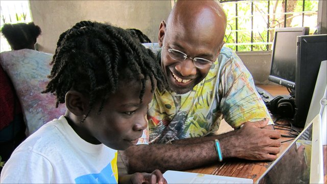 MIT Professor Michel DeGraff with a student at the Matenwa Community Learning Center in Haiti. Photo by Chris Low.