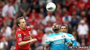 Leiva Lucas of Liverpool closes down Stephane Sessegnon of Sunderland at Anfield, a popular destination for tourists