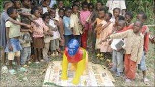 Children with gorilla at Metet School, Cameroon