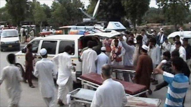 The injured being taken to hospital