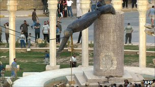 A bronze statue of Saddam Hussein is pulled down in central Baghdad after US forces enter the city, 2003