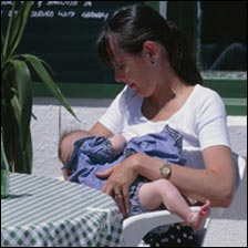 Woman breastfeeding at a cafe