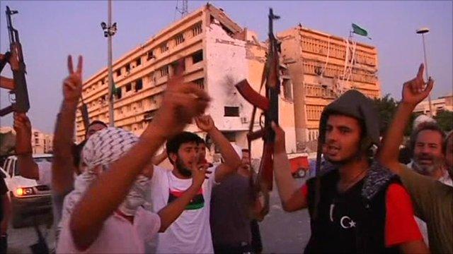 Rebel fighters celebrate
