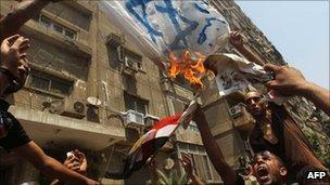 Egyptian demonstrators burn an Israeli flag during a protest outside the Israeli embassy in Cairo . Photo: 20 August 2010