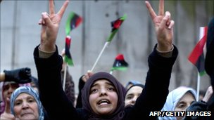 A young girl gestures towards the Libyan Embassy in London as several hundred demonstrators gathered to protest when the uprising began in February