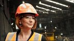 """Australian Prime Minister Julia Gillard gives the thumps up to steel workers at OneSteel""""s mill in the Melbourne suburb of Laverton, on July 12, 2010"""