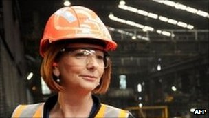 "Australian Prime Minister Julia Gillard gives the thumps up to steel workers at OneSteel""s mill in the Melbourne suburb of Laverton, on July 12, 2010"