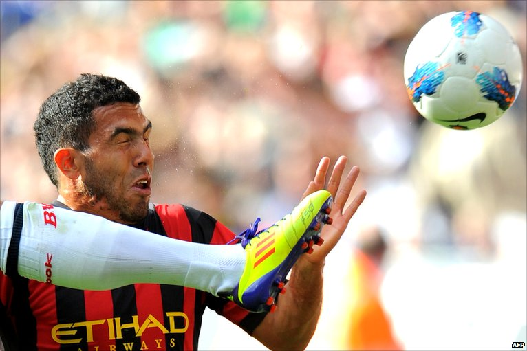Tevez challenging for the ball