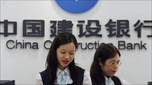 China Construction Bank employees at a branch in Hong Kong