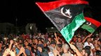 Libyan rebels in a part of Tripoli called Tajura celebrate