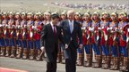 US Vice-President Joe Biden chats to Mongolian Prime Minister Sukhbaatar Batbold as they inspect an honour-guard in Ulan Bator on 22 August 2011