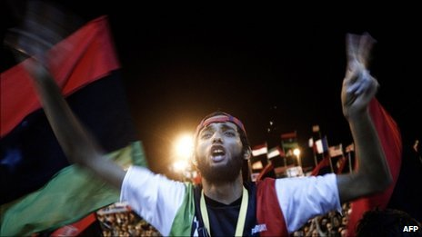 Tens of thousands of Libyans celebrate the arrest of Col Gaddafi's son, Saif al-Islam, and the partial fall of Tripoli into the hands of the Libyan rebels on 21 August 2011 in Benghazi, Libya