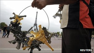Man selling copies of the Eiffel Tower in Paris